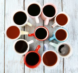 overhead shot of a group of mugs filled with coffee