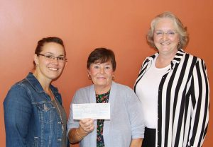 ROHCC Director Jessica VanEs (left) accepts a $7,500 cheque from Ann Moore and Linda Heber of the Nurses Entrepreneurial Foot Care Association.