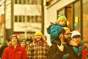 A small boy rides on his father's shoulders during Ray of Hope's Coldest Night of the Year walk