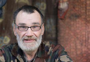 Homeless man wearing glasses