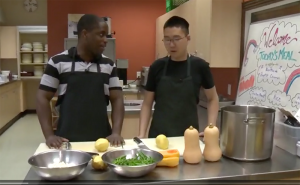 Reporters Start Gooden tallks to Nathan, a Youth Employment Program participant in Ray of Hope's kitchen