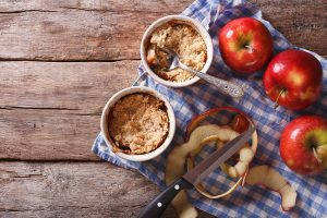 apple crisp with peeled apples on a barnyard background