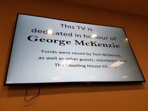 TV screen on an orange wall
