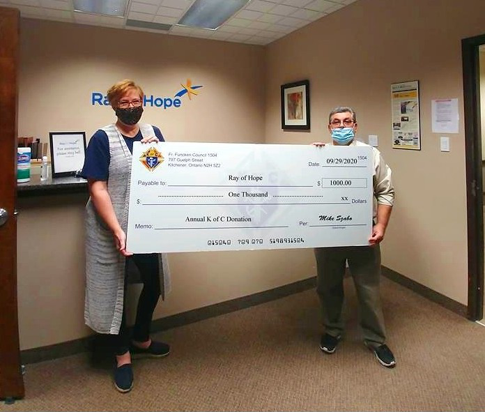 Tonya Verburg and Mike Szabo hold a giant cheque